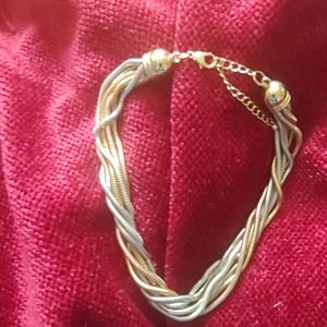 Gold, silver and rose gold twisted necklace.